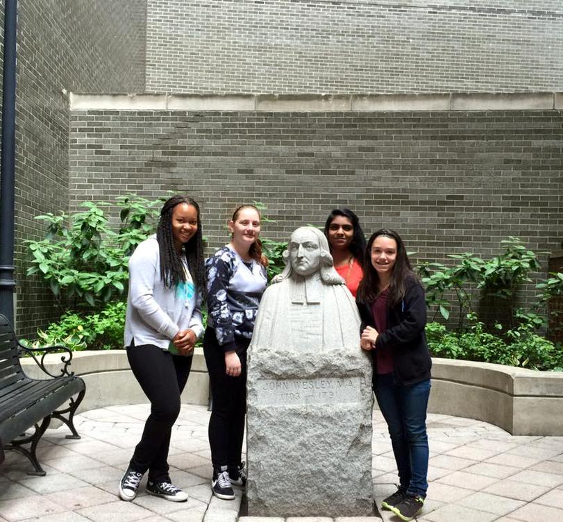 Confirmands with the bust of John Wesley
